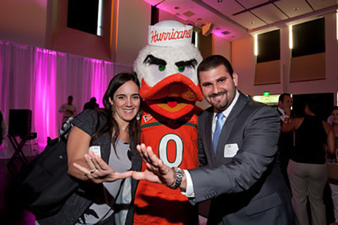 Alumni posing with Sebastian at an event